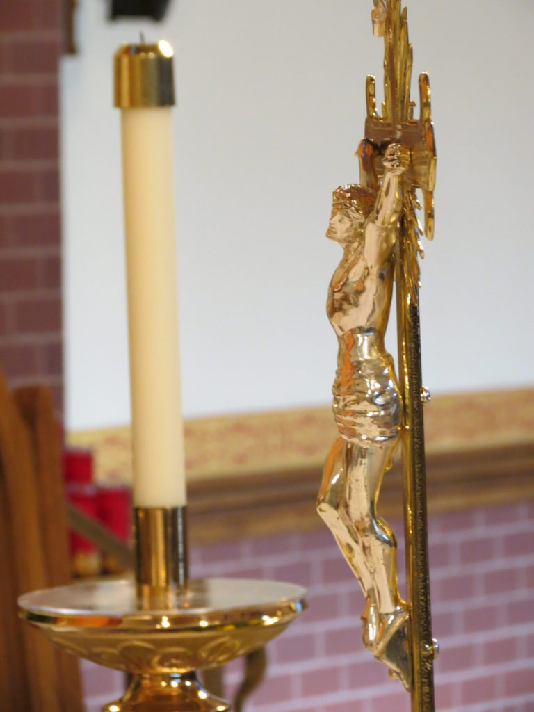 jesus statue and candle